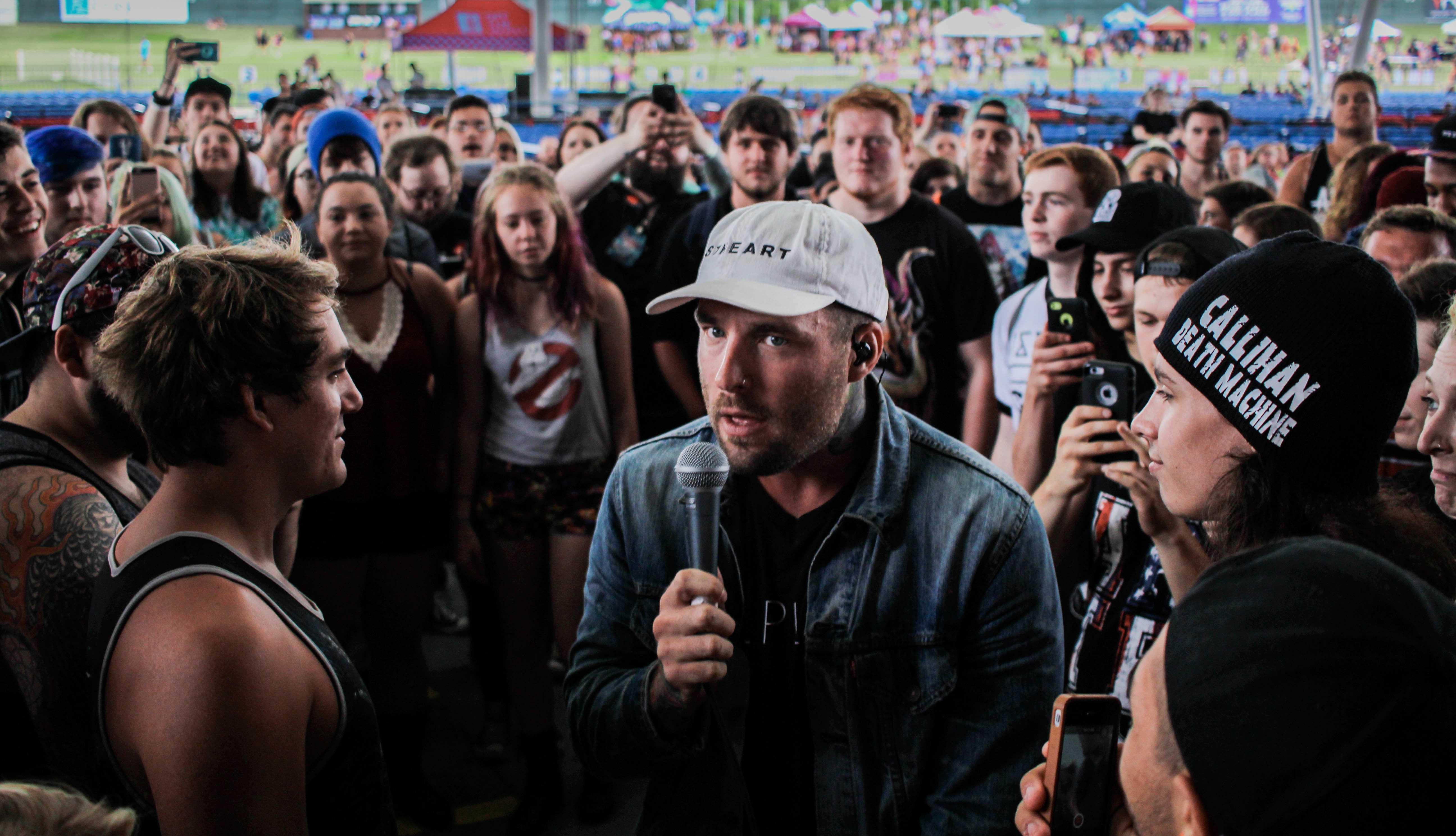 Bradley Waden, vocalist of Emarosa, joins the crowd at the Vans Warped Tour